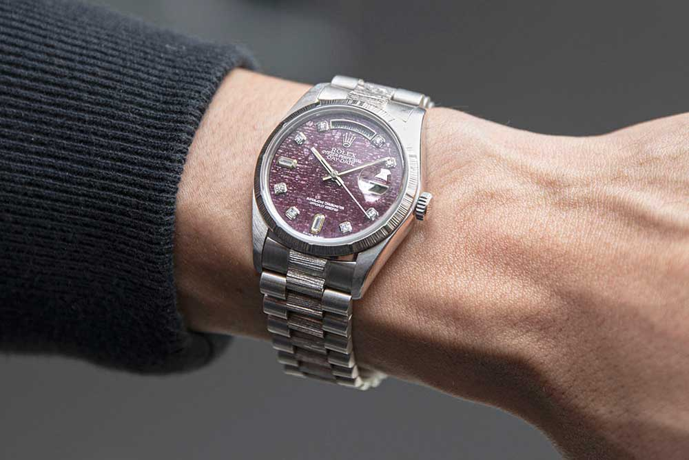 Rolex Day-Date reference 18079 featuring a rubellite dial with baguette-cut diamonds at six and nine o'clock. This gorgeous watch can be seen at Revolution's Watch Bar in Singapore (© Revolution)