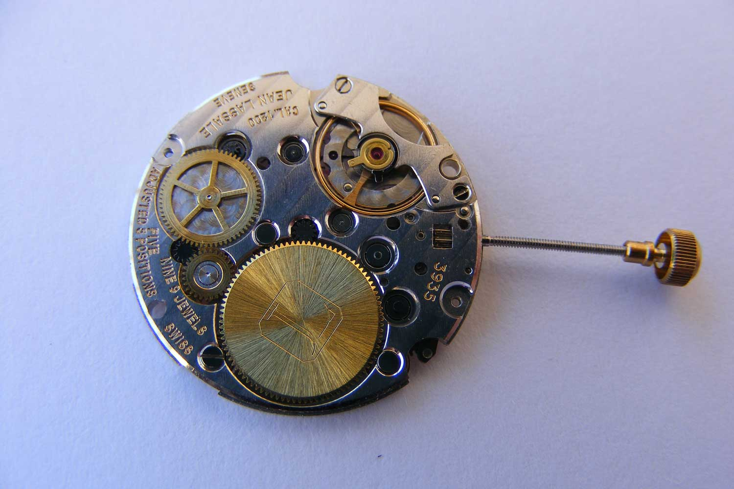 In 1976, Jean Lassale created a manual wind caliber that was a mere 1.2mm in thickness and named the Calibre 1200; the barrel and gear train of this movement was suspended meaning they were only supported from one point from the back rather than having an upper bridge, this meant they couldn't be supported with traditional jeweled pinions, they were secured in place using ball bearings (Image: commons.wikimedia.org)