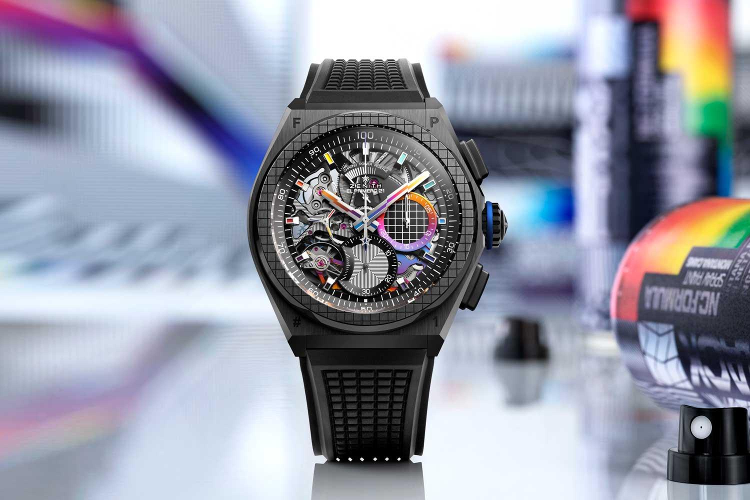 To achieve a rainbow effect on the watch's multi-colored bridges, Zenith utilized three-dimensional PVD with silicon particles as a surface treatment on the movement.