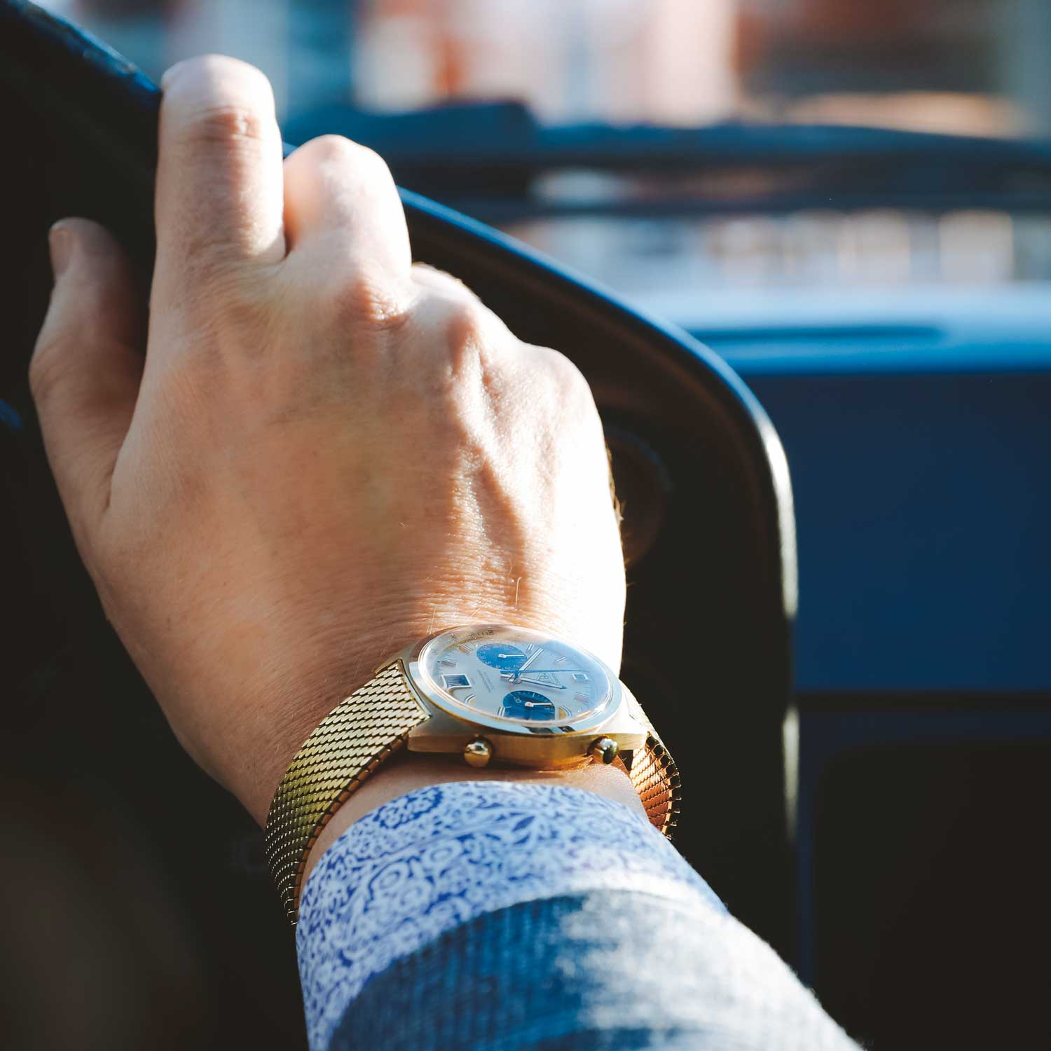 Haslinger was already passionate about cars before he got hooked on watches. Seen here on Haslinger's wrist is the Heuer Carrera 1158 CHN on gold band.