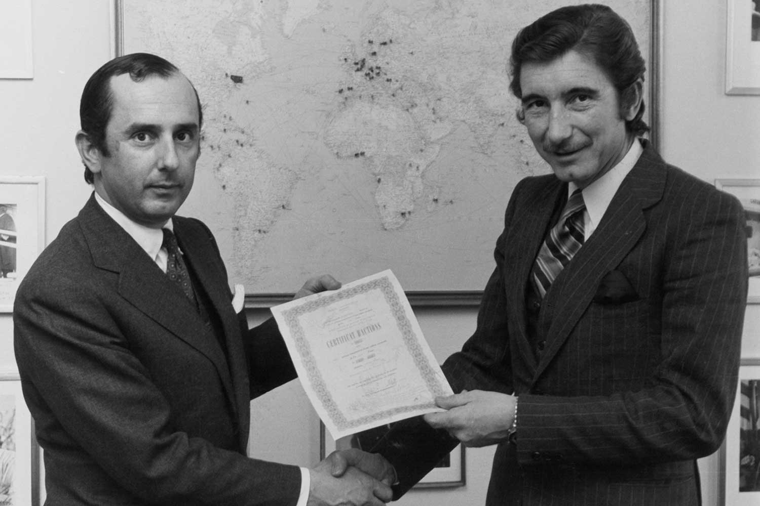 Jack Heuer (left) with Jo Siffert. Siffert was one of the first Formula 1 drivers to be sponsored by a watch company when Heuer signed a partnership deal with him in 1968