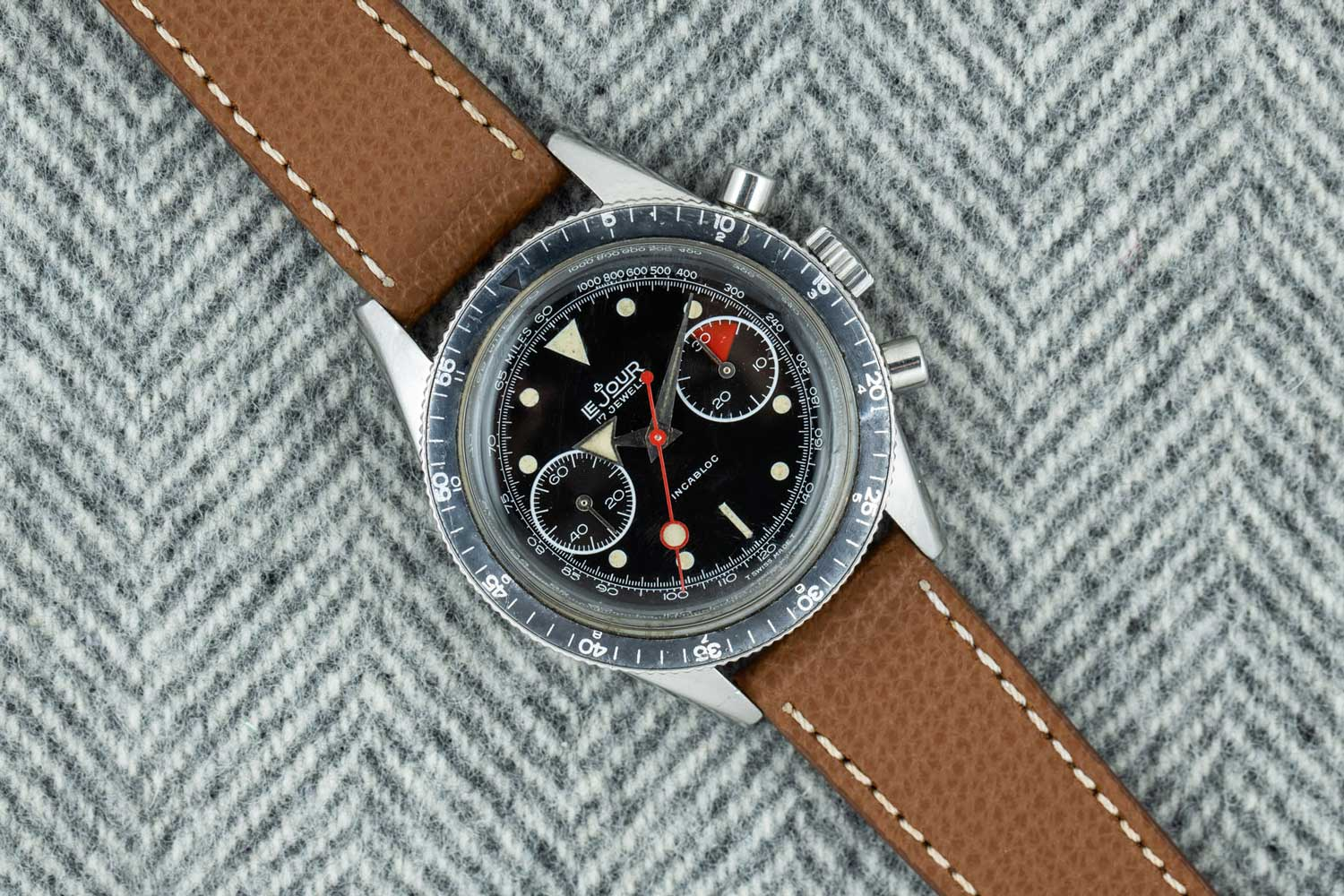 """The LeJour """"Broad Arrow"""" Chronograph has a faded bezel, an arrowhead hour hand and a giant lollipop on the red seconds hand.(Image: AnalogShift.com)"""