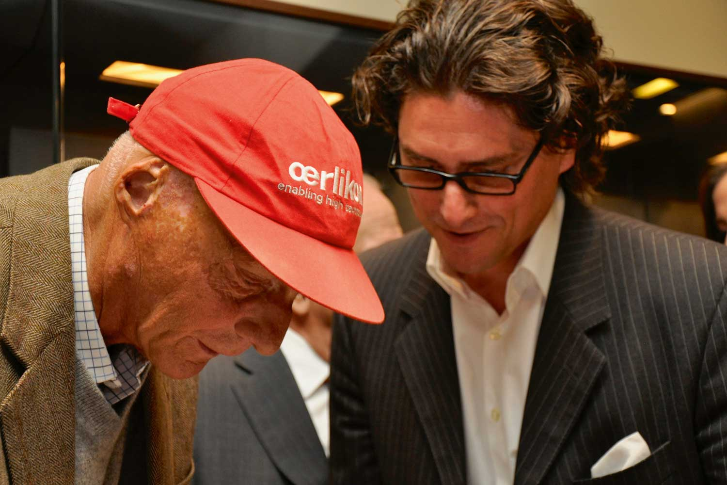 Niki Lauda and Arno Haslinger at a joint TAG Heuer/ Bonhams/Haslinger Collection sale at the Köck Boutique in 2010.