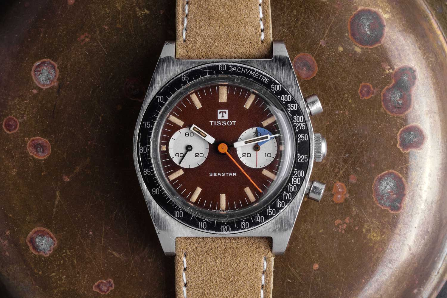 With its tropical oxblood dial and chunky handset, this reliable Lemania manual wind Tissot Seastar Chronograph is simply irresistible (Image: CraftandTailored.com)