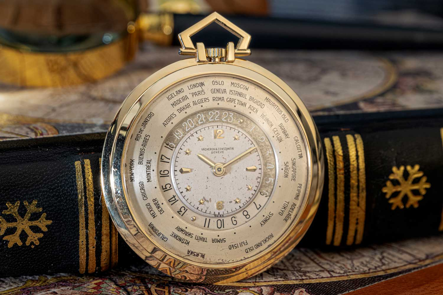 1949: Reference 4414 Heure Universelle Pocket Watch; 18K yellow gold open-face worldtime pocket watch; silvered dial made in 3 parts; 24-hour disk divided in two zones, dark blue zone for the night hours and silvered for the daylight hours; external fixed disk graduated with the name of 41 cities and places (©Revolution)