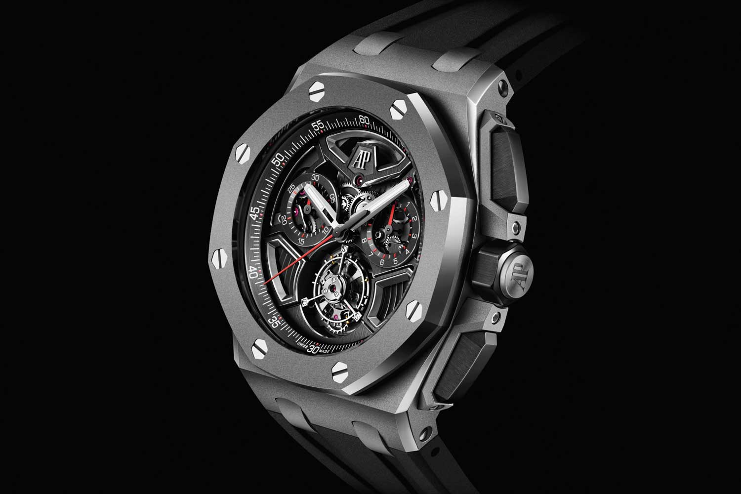 The new 43 mm Royal Oak Offshore self-winding flying tourbillon flyback chronograph with a sandblasted titanium case, architectural dial and black interchangeable rubber strap.