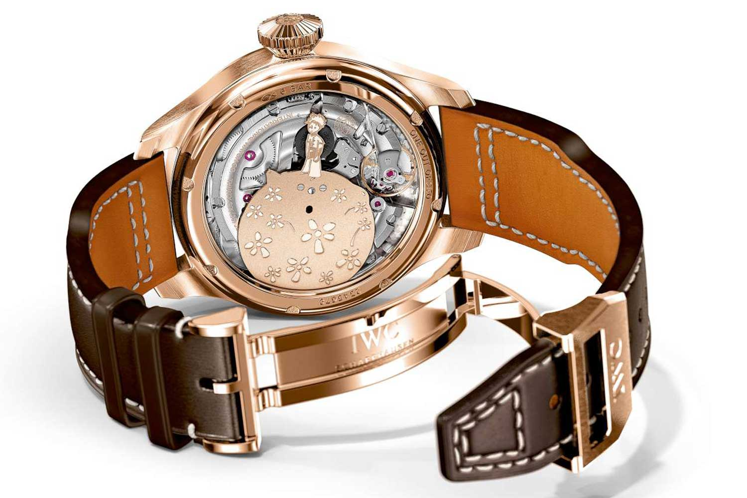 """The sapphire caseback of the """"Le Petit Prince"""" Big Pilot Annual Calendar with solid-gold rotor in the shape of the little prince standing on his asteroid."""