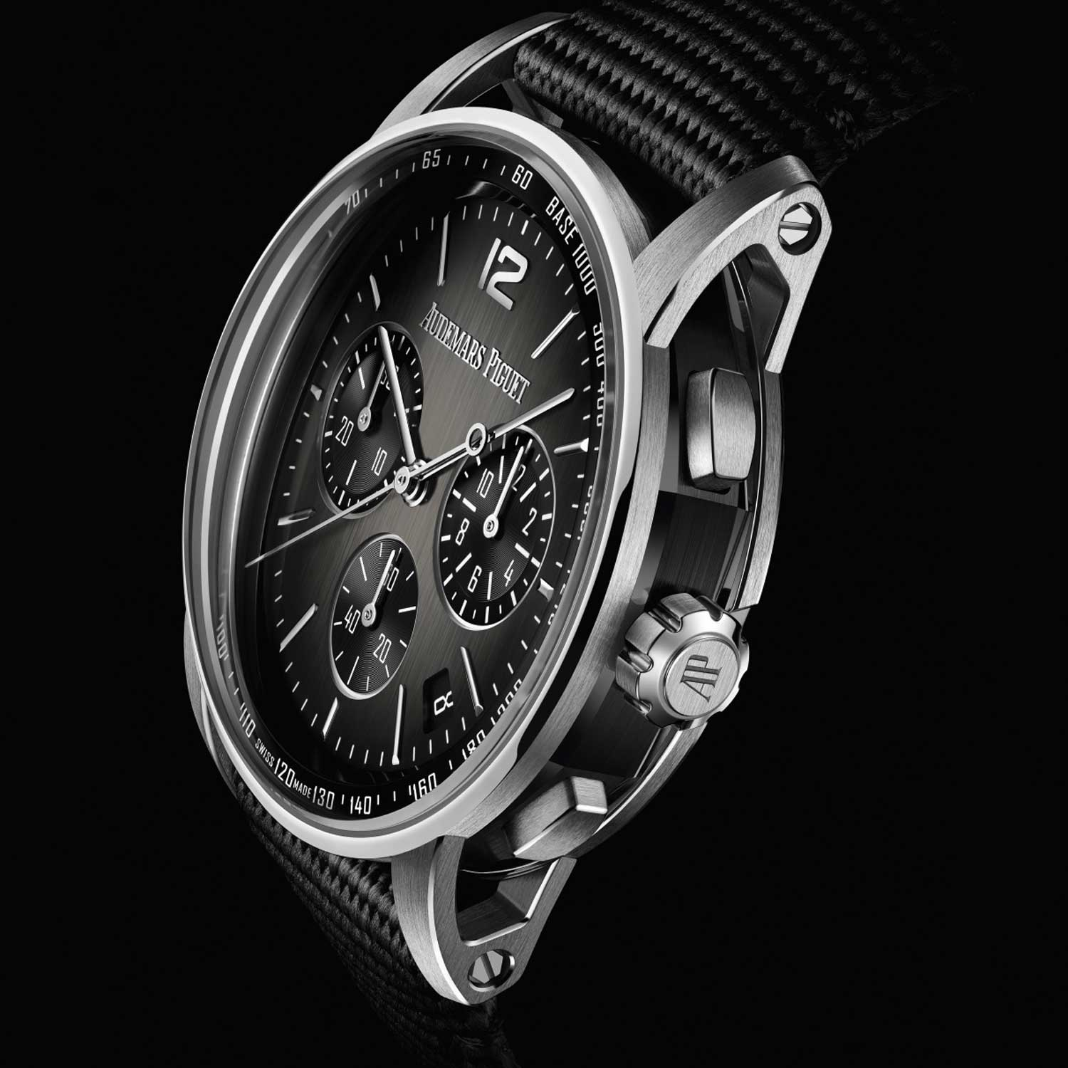 The new Code 11.59 in 18k white gold case with black ceramic middle case, smoked grey lacquered dial and black rubber-coated strap.
