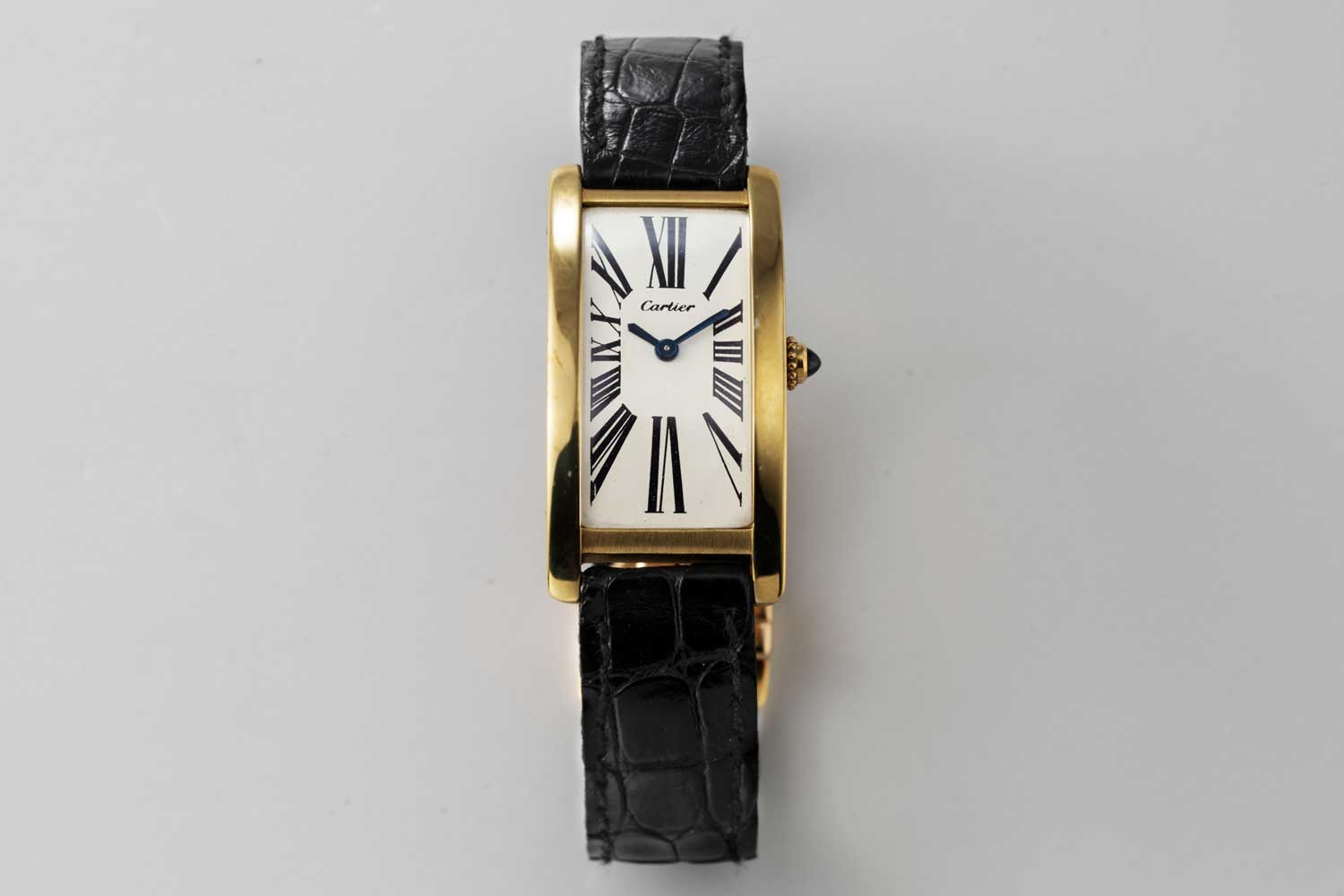 A 9-lignes, 1969 London Cartier Tank Cintrée; dial of the watch has a design which features serif Roman numerals that almost seem to explode from the center of the dial and reach for the edge of the case with a thrilling vibrancy; this particular example is from the private collection of Auro Montanari (©Revolution)
