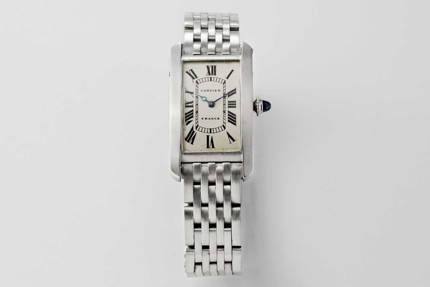 1930 Cartier Platinum Tank Cintrée made in France, medium size with original pt. 7-link bracelet; this particular example is from the private collection of Auro Montanari (©Revolution)