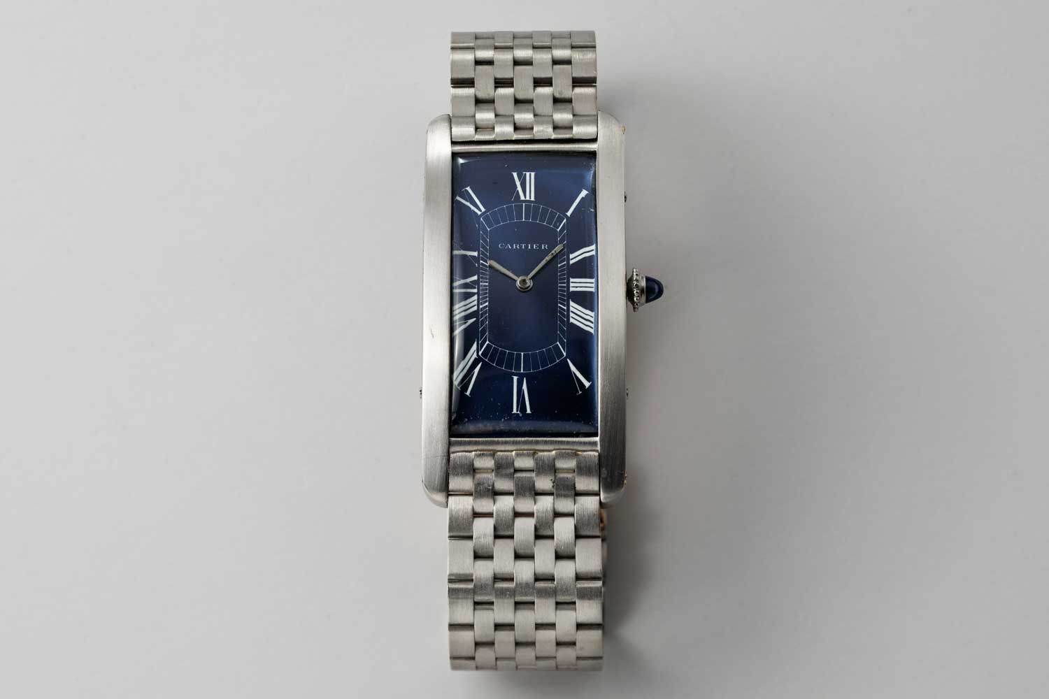 1929 platinum Cartier Paris Tank Cintrée with European Watch movement; In the middle of the 1990s a special order was made with Paris for a new blue dial with white Roman numerals, ie the dial placed in the case at the moment is not the same one from 1929; this particular example is from the private collection of Auro Montanari (©Revolution)