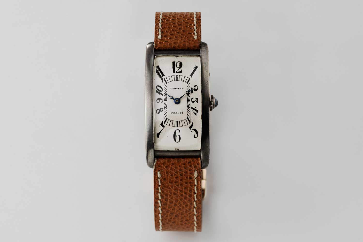 1926 made in France Cartier Tank Cintrée, possibly pièce unique with a silver case and elongated Arabic numerals; powered by a European Watch movement; this particular piece is from the private collection of Auro Montanari (©Revolution)