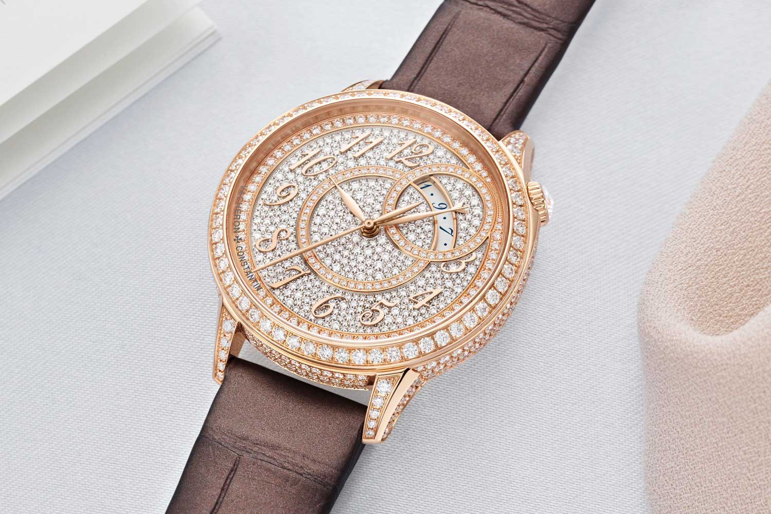 The self-winding Égérie watches are adorned with 574 round-cut diamonds