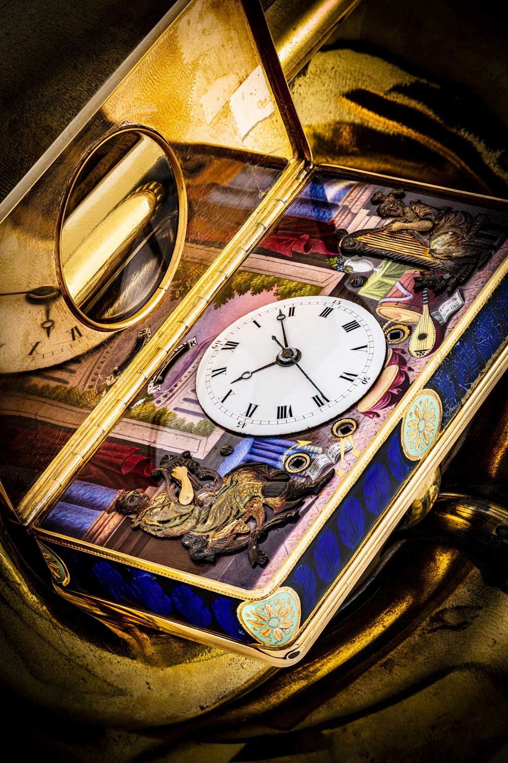 An 18k gold and enamel musical box with automaton and centre seconds watch from 1815