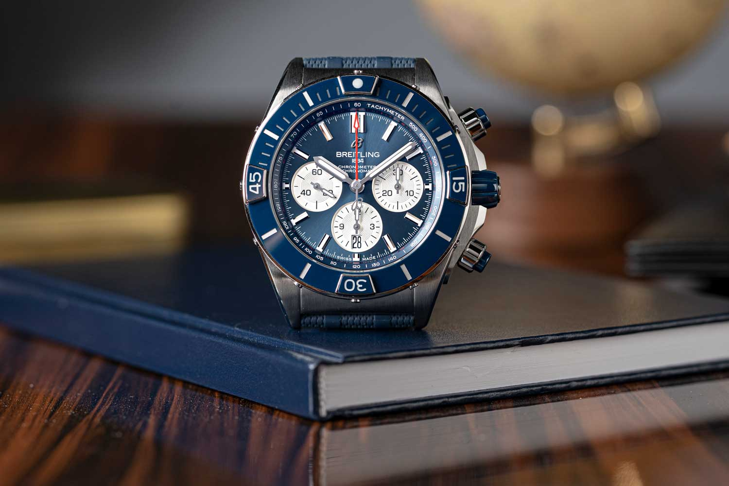 The Super Chronomat B01 44 in stainless steel, seen here with a blue dial and ceramic insert (©Revolution)