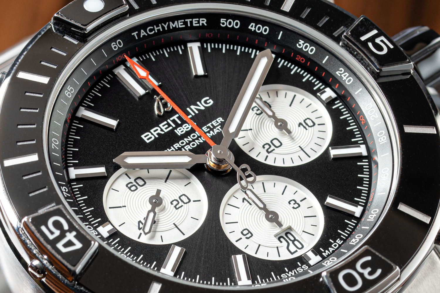 Rider tabs incorporated onto the bezel of the Super Chronomat B01 44 have a dual, or arguably triple, purpose. Firstly, they are there to protect the crystal and secondly they allow the wearer, in theory a pilot, to easily operate the bezel whilst wearing gloves (©Revolution)