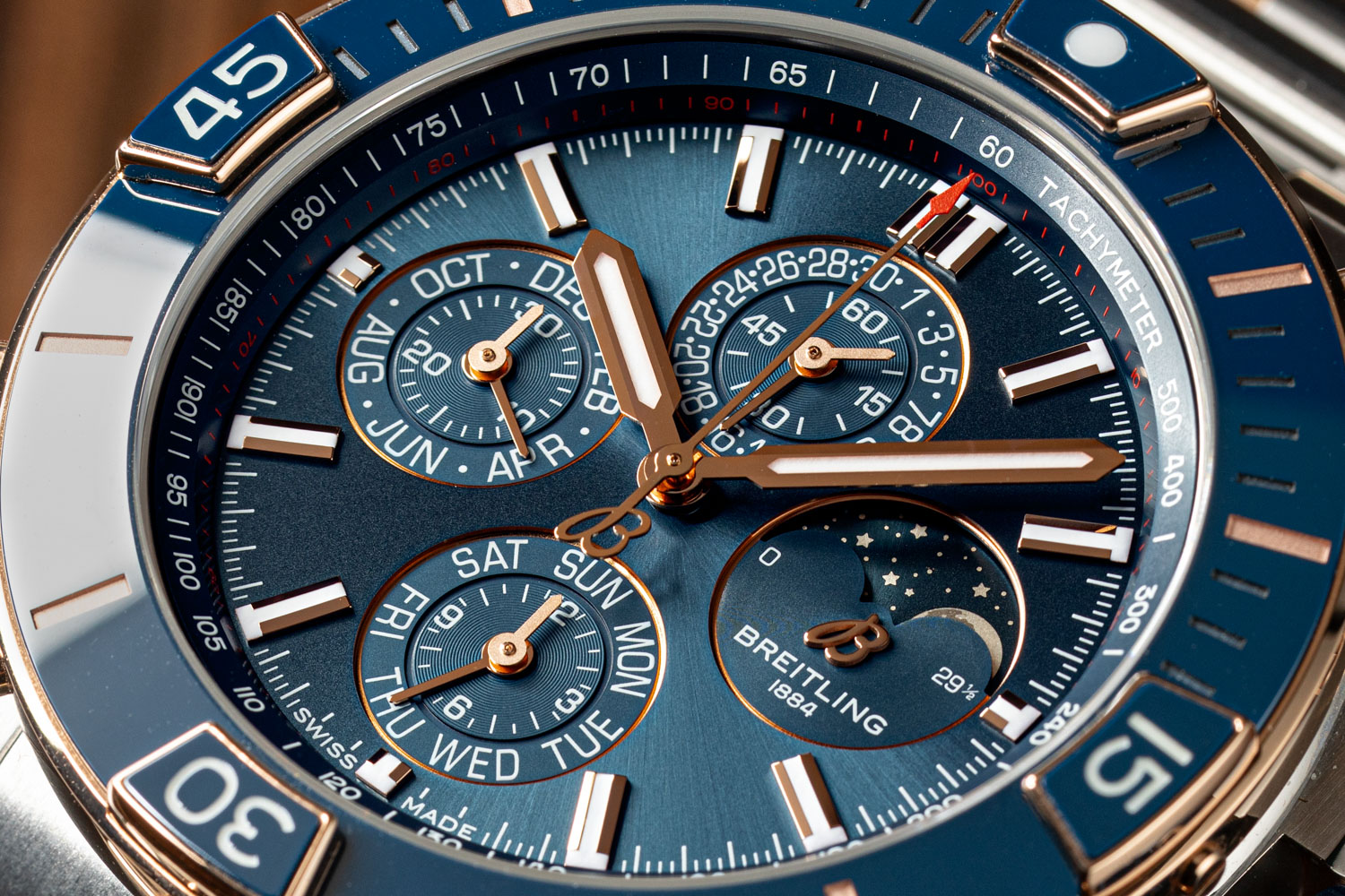 Super Chronomat 44 Four-Year Calendar in the blue dial variation has stainless steel case and its bezel is 18 k red gold with blue ceramic insert, unidirectional ratcheted, indexes and Super-LumiNova® coated rider tab numerals (©Revolution)