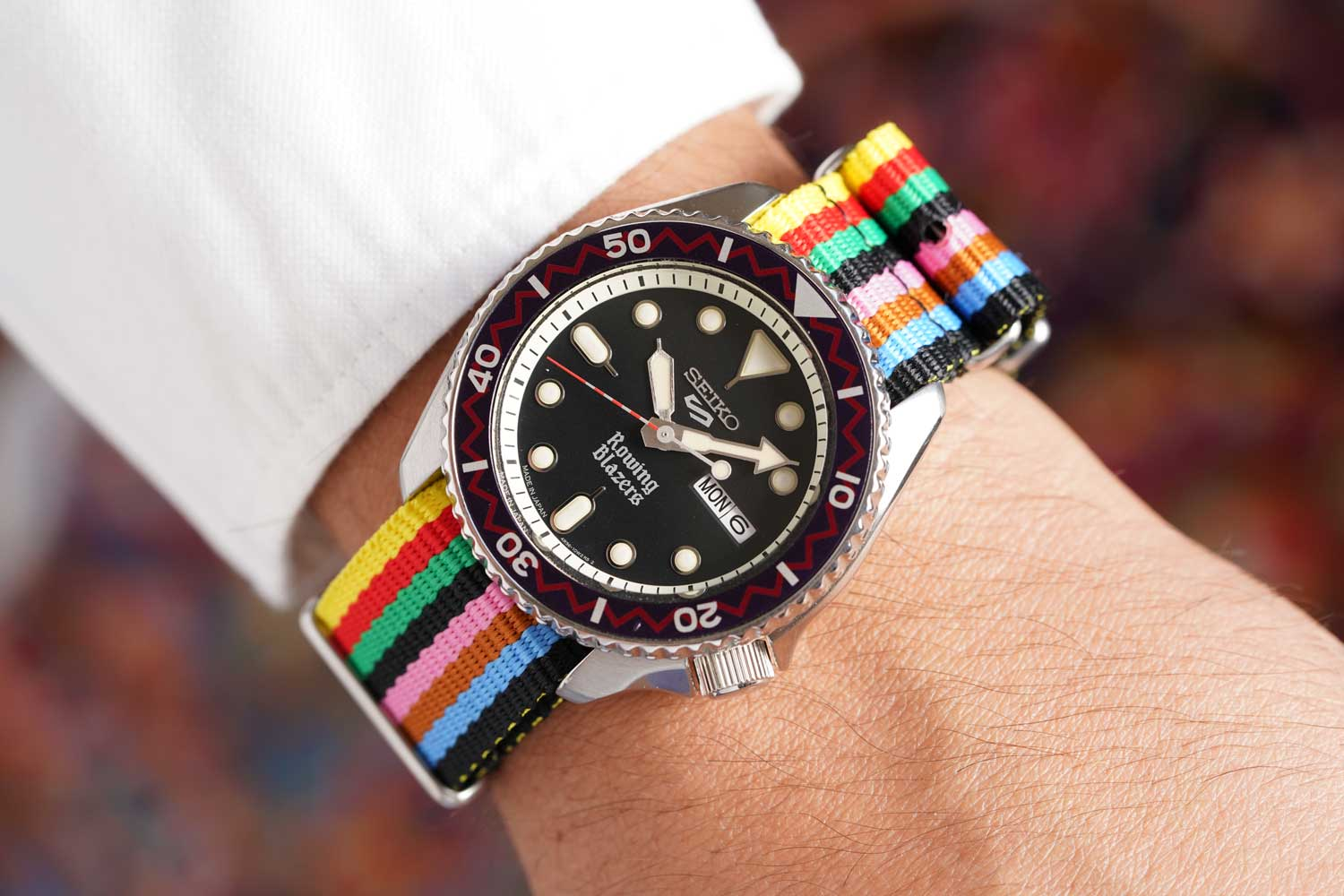 """The watch takes on a completely different look with the brand's signature """"croquet"""" stripe strap."""