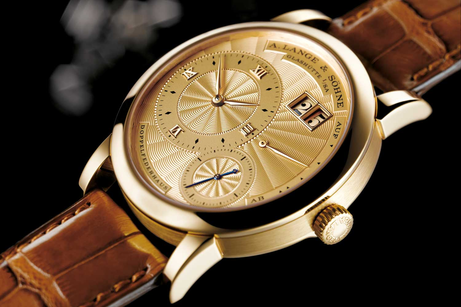 """In the 19th century, the designation """"1A"""" was used by A. Lange & Söhne to identify watches crafted from the very finest materials and finished to the highest degree of perfection. In 1998, Lange presented the LANGE 1A as a reminiscence of this heritage. It has a solid-gold lever and escape wheel, a solid-gold pallet cock, escape-wheel cock, and balance cock, as well as a solid-gold guilloched dial. Additionally, this masterpiece features all of the refinements that make the LANGE 1 such a precious watch. In 1998 and 1999, the LANGE 1A was crafted in a limited edition of 100 pieces in yellow gold."""