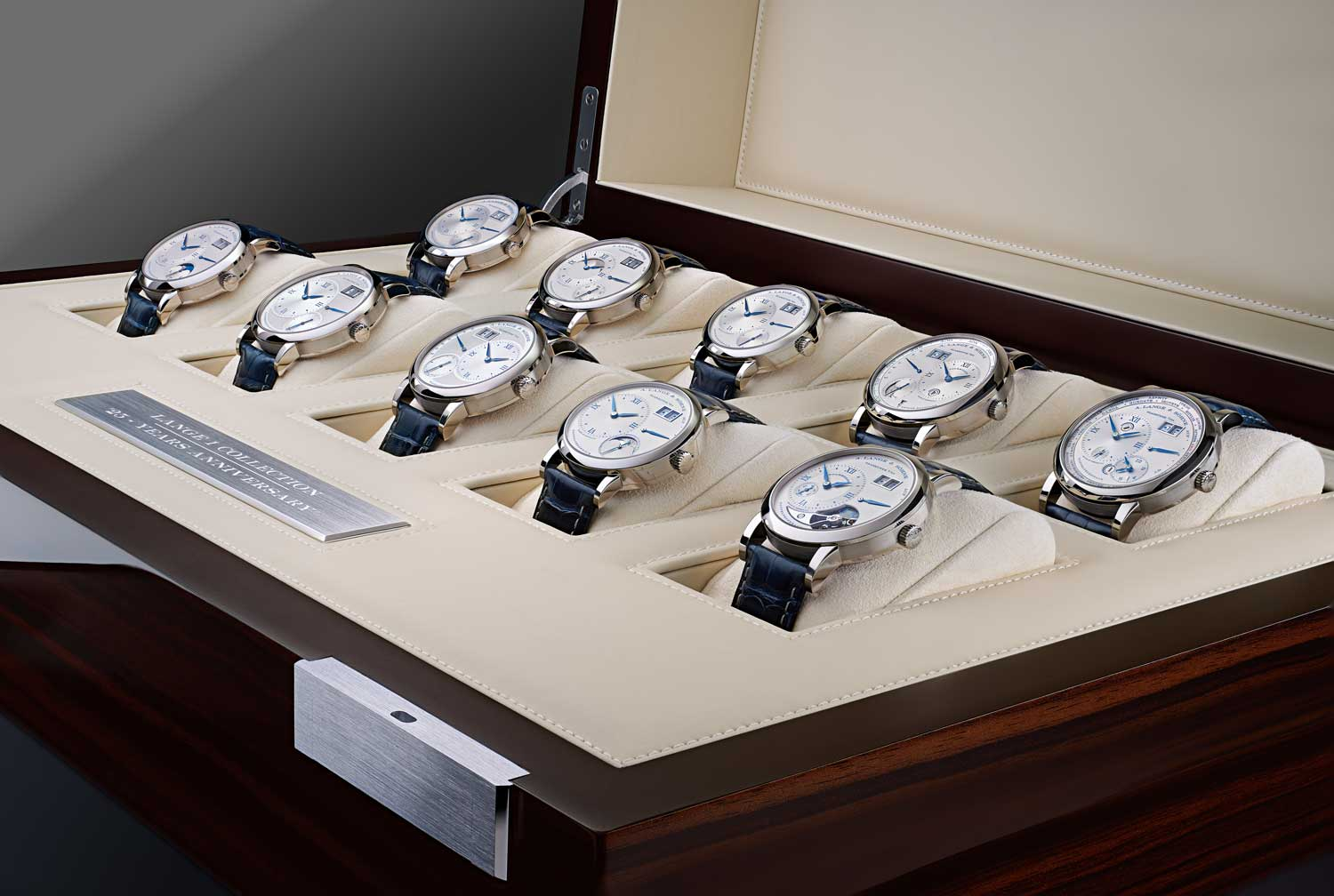 """On the occasion of the Lange 1's 25th anniversary, the brand produced ten executions of various Lange 1 watches with argent-coloured dials made of solid silver with deep-blue numbers, hour markers and date numbers, as well as a special engraving done by hand: the anniversary number """"25"""" is shown in a characteristic outsize-date window, framed by a floral pattern"""