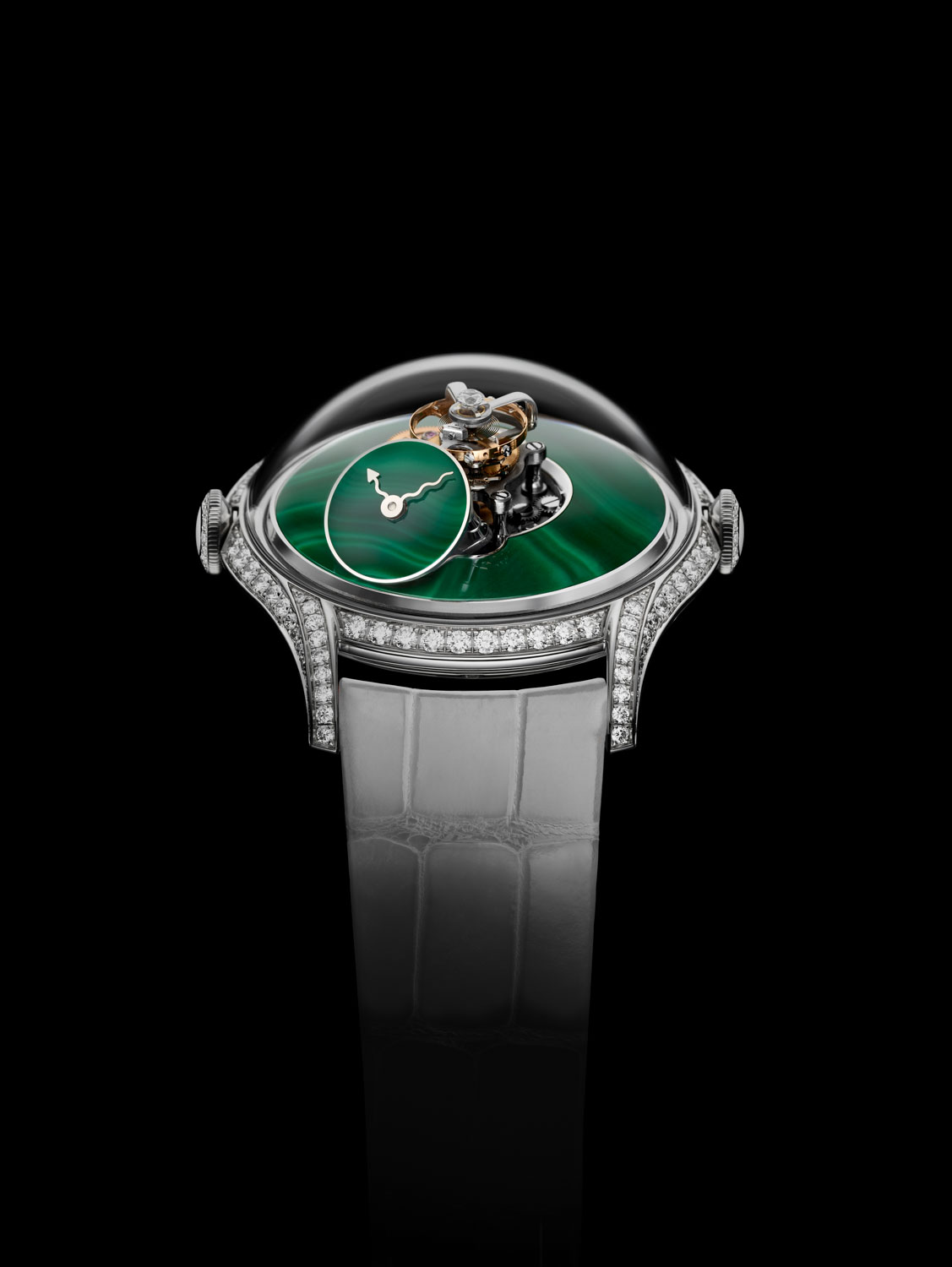 The LM FlyingT, featuring a dial plate and subdial in the vibrant green gemstone, called malachite