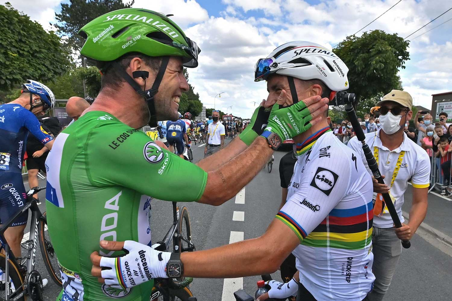 Britain's Mark Cavendish, wearing the best sprinter's green, celebrates with France's Julian Alaphilippe after winning the sixth stage of the Tour de France cycling race over 160.6 kilometers (99.8 miles) with start in Tours and finish in Chateauroux, France, Thursday, July 1, 2021. (David Stockman, Pool Photo via AP
