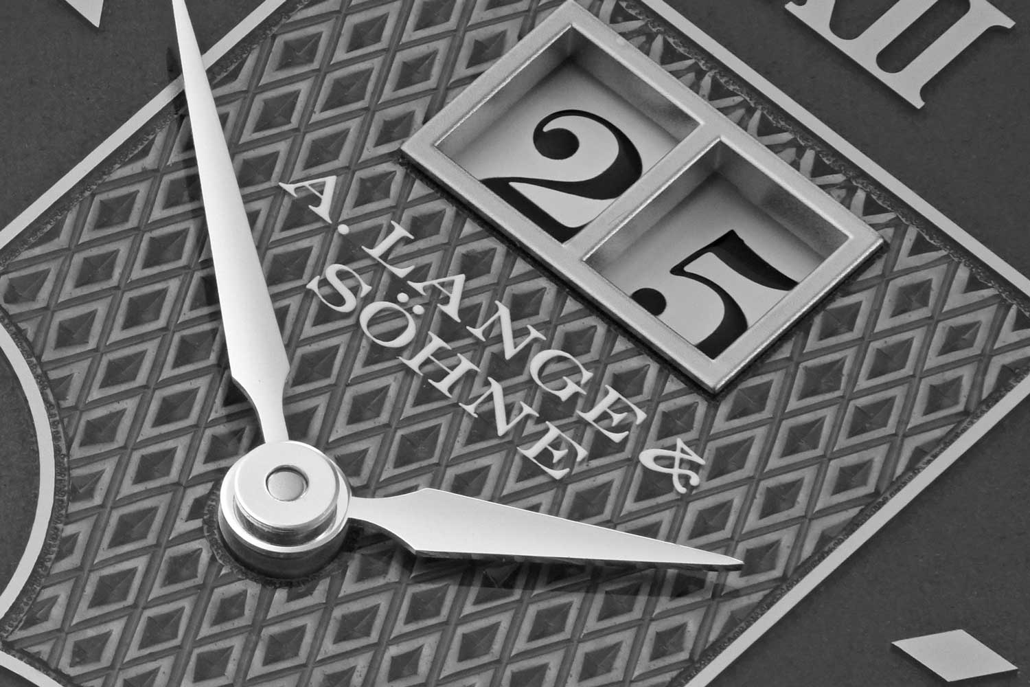 The dial of the Cabaret Tourbillon Handwerkskunst features a hand engraved lozenge pattern and semi-transparent enamelling applied over it; the name of Lange is printed on top of the semi-transparent enamelling such that from certain angles, the words appear to afloat over the dial (©Revolution)