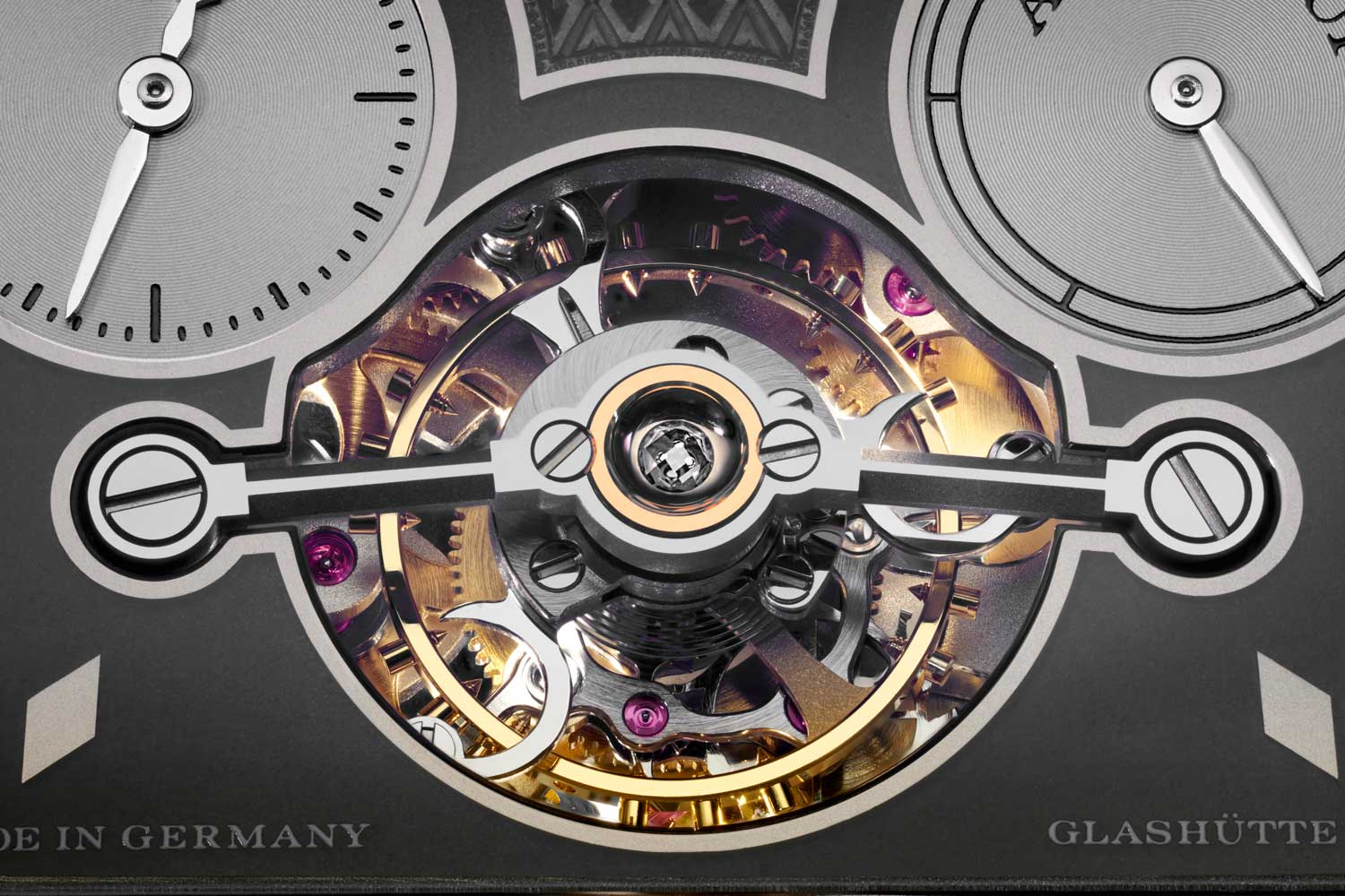 The aperture created for the subdials and the tourbillon presented the team at Lange a sizeable challenge in balancing proportions and material tolerances; the subdials are white gold and rhodium, and are inserted into the dial from the back; the endstone we see on top of the tourbillon here is a piece of diamond, there is a second one that is placed on the other end holding the tourbillon in place (©Revolution)