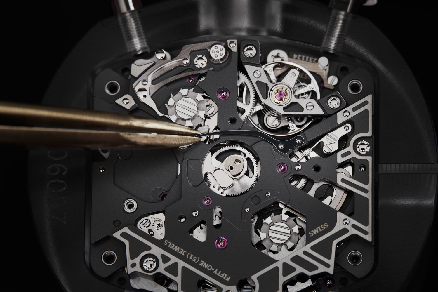 Seeing is believing, the RMAC4, although based off the VMF 6710, looks nothing like it and features a split seconds function, a rapid winding pusher that can fully wind the movements barrel with 125 pushes and a variable inertia/geometry rotor that can be set up to correspond to the owner's level of energy output; the RMAC4 also has every bridge made out of grade 5 titanium before it is fully skeletonized