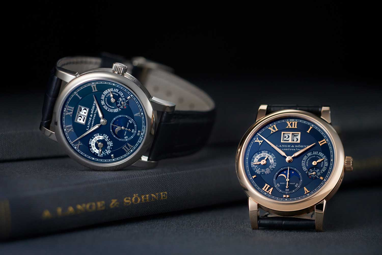 The 2021 A. Lange & Söhne Langematik Perpetual – Ref. 310.028 & 310.037, in white and pink gold with blue dials to mark the watch's 20th birthday (©Revolution)