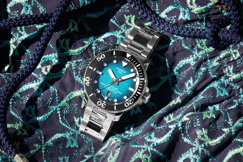 The Tissot Seastar 2000 has a rich cerulean blue dial that fades at the edges to a deep navy.