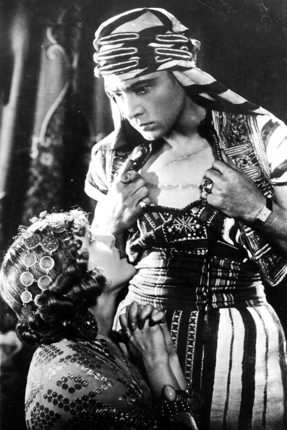 Vilma Banky and Rudolph Valentino in the 1926 film, Son of the Sheik where Valentino insisted on wearing his treasured Cartier Tank during the filming