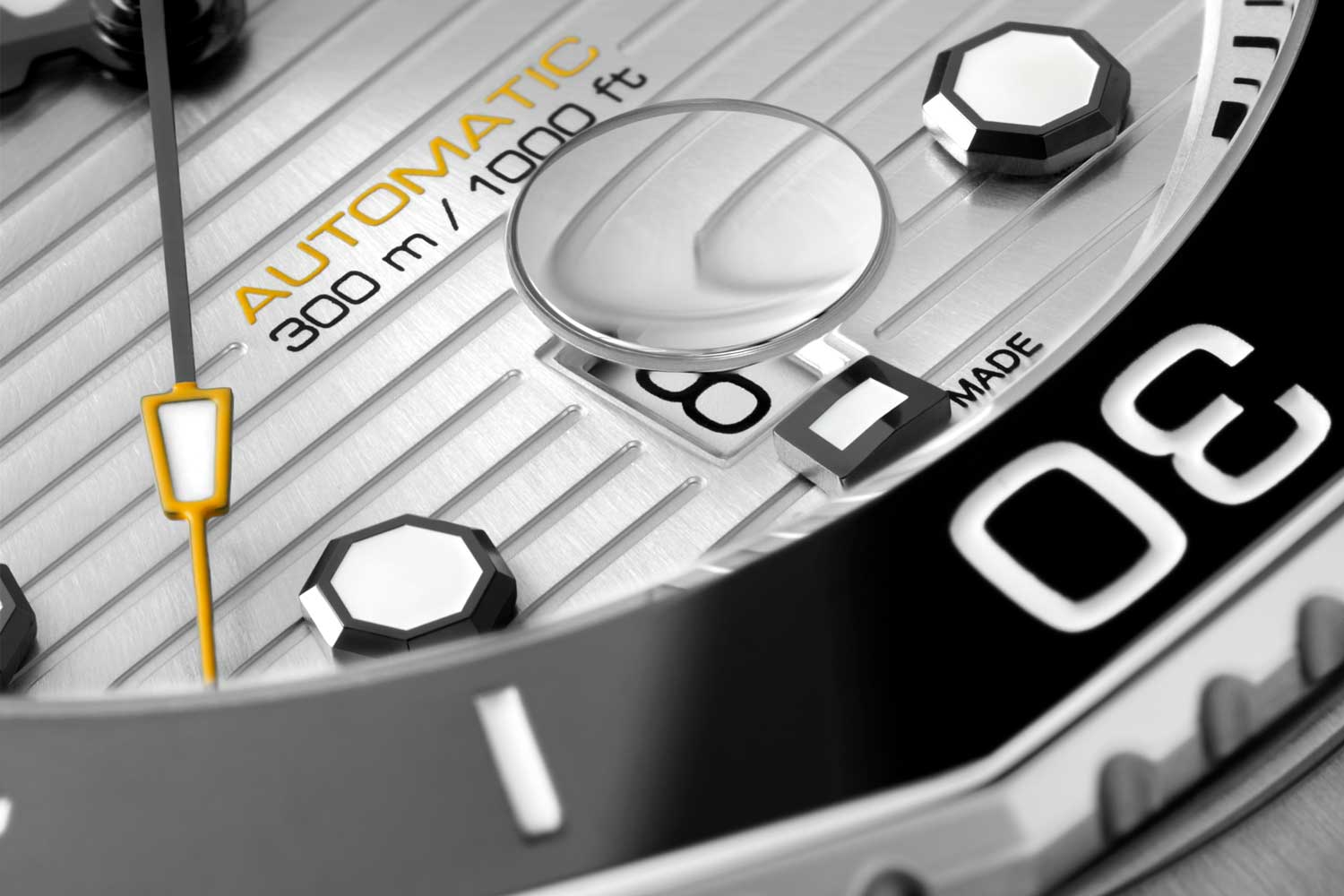 The Aquaracer watches have a date cyclops mounted under the sapphire crystal with all date windows now at six o'clock.