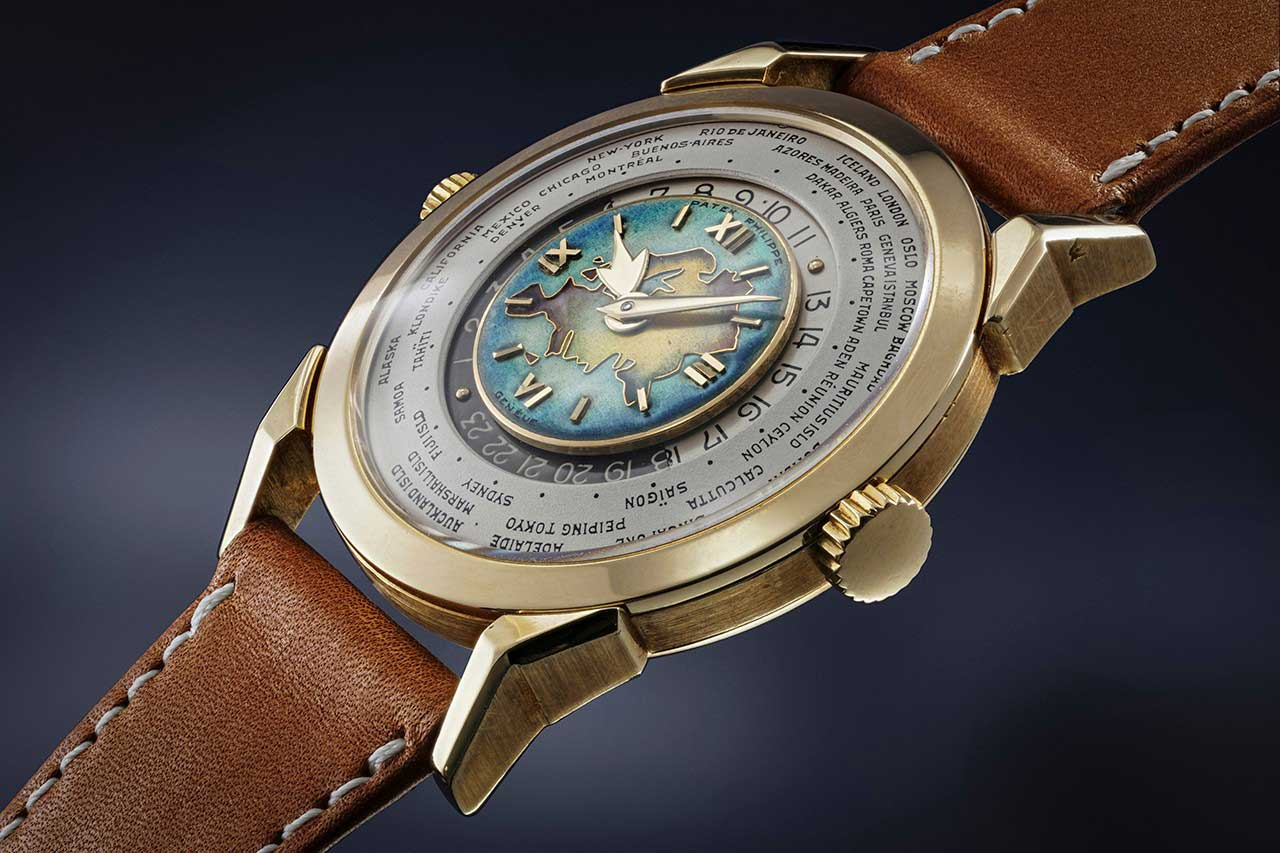 At Phillips' Geneva Auction XIII, the Patek Philippe ref. 2523 set the record both for a two-crown world time watch (with a cloisonné enamel dial) and for any yellow gold wristwatch sold at auction