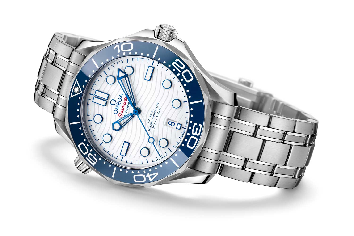 """The Seamaster Diver """"Tokyo 2020"""" Edition continues the clean, minimal design theme in a colorway of blue, white and just a hint of red."""