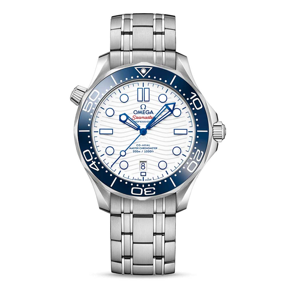The watch has a polished white ceramic dial with laser-engraved waves, along with blued indexes and hands, and 'Seamaster' highlighted in red.