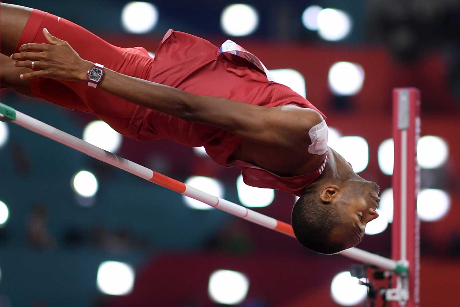 Qatar's Mutaz Essa Barshim competes in the Men's High Jump final at the 2019 IAAF Athletics World Championships at the Khalifa International stadium in Doha on October 4, 2019, with the with the RM 67-02 Automatic Mutaz Essa Barshim – High Jump on his wrist (Photo by Kirill KUDRYAVTSEV / AFP) (Photo by KIRILL KUDRYAVTSEV / AFP via Getty Images)