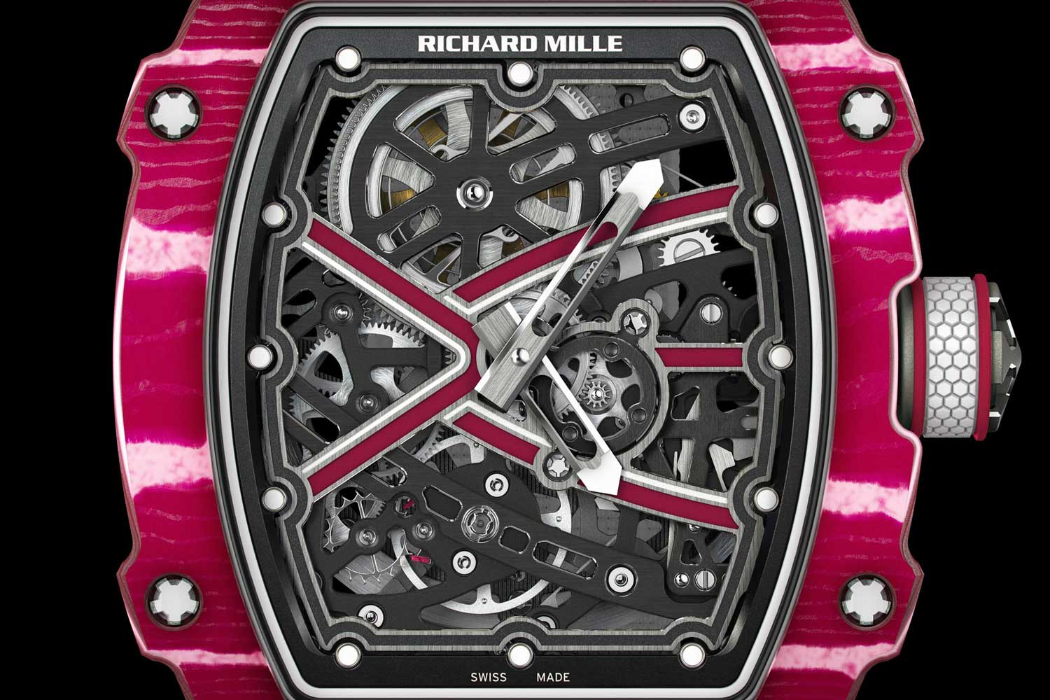 The RM 67-02's dial is integrated into the baseplate of the watch, you can see all the inner mechanical elements, including the escapement wheel at seven o'clock, the balance wheel just to the left of six o'clock, and the skeletonized barrel at 12 o'clock, which also allows you to gauge the state of wind of the mainspring inside