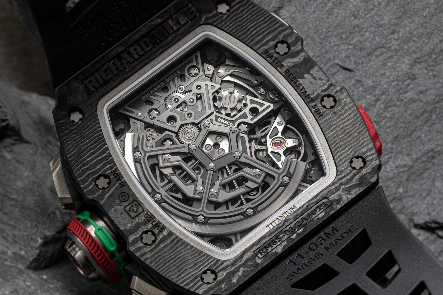 Seeing is believing, the RMAC4, although based off the VMF 6710, looks nothing like it and features a split seconds function, a rapid winding pusher that can fully wind the movements barrel with 125 pushes and a variable inertia/geometry rotor that can be set up to correspond to the owner's level of energy output; the RMAC4 also has every bridge made out of grade 5 titanium before it is fully skeletonized (©Revolution)