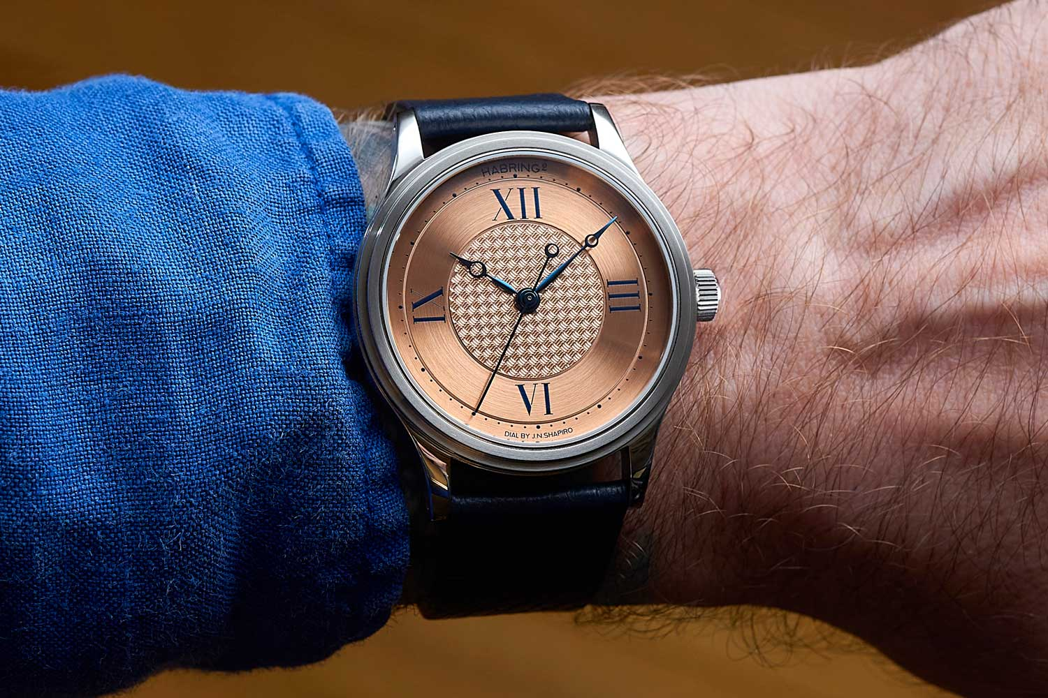 The warm salmon tones are the perfect way to show off the fine basket weave guilloché on the dial made by J.N. Shapiro