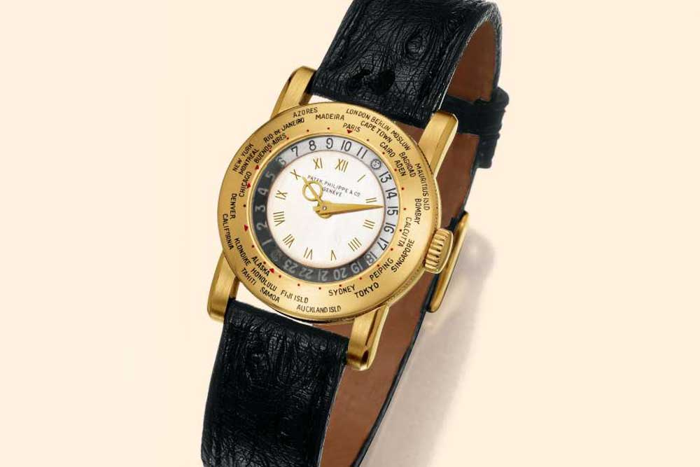 Patek Philippe's 1937 ref. 542 HU, which has a bezel that displays Honolulu with a red triangle as a half time zone, between Alaska and Samoa zones. (Image: Antiquorum)