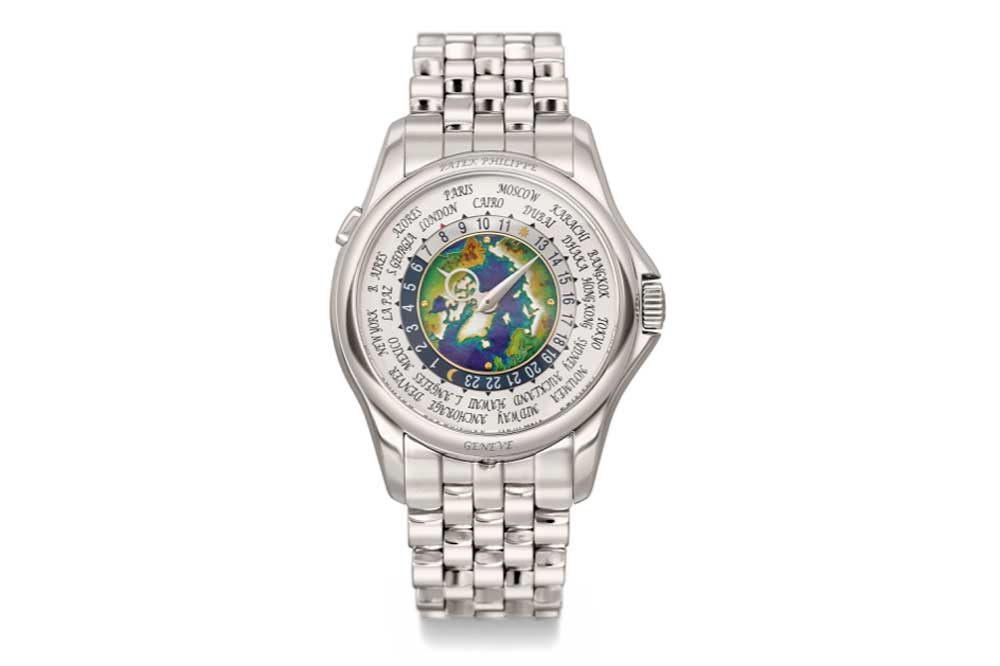 """In 2018, Patek Philippe launched the ref. 5131/1 P that featured an enamel map of the Northern Hemisphere and """"Eric Clapton"""" style brick bracelet. (Image: Sothebys)"""