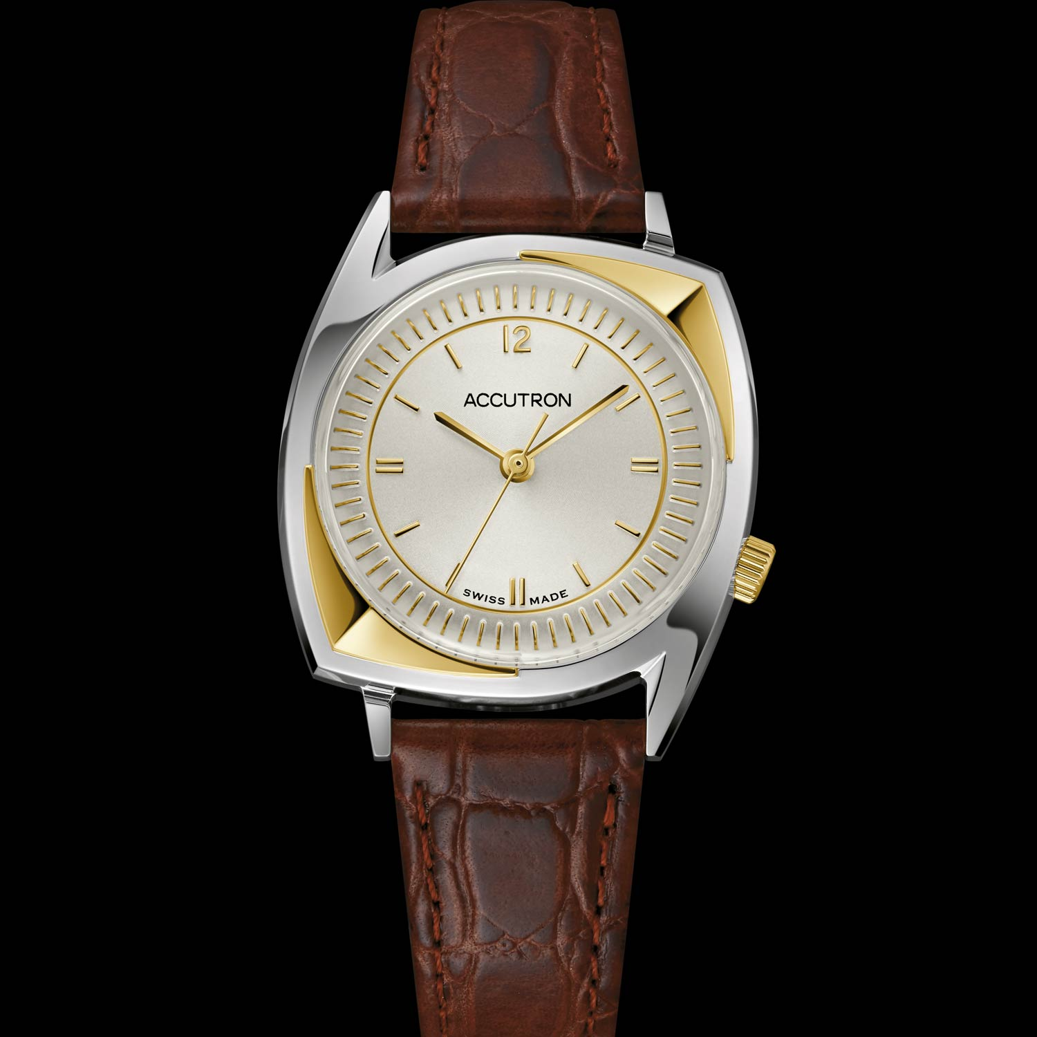 """The """"203 Football Gold Relief'' watch's design has been upgraded with a 34mm gold-and-silver-tone stainless steel case and a 3-hand champagne dial."""
