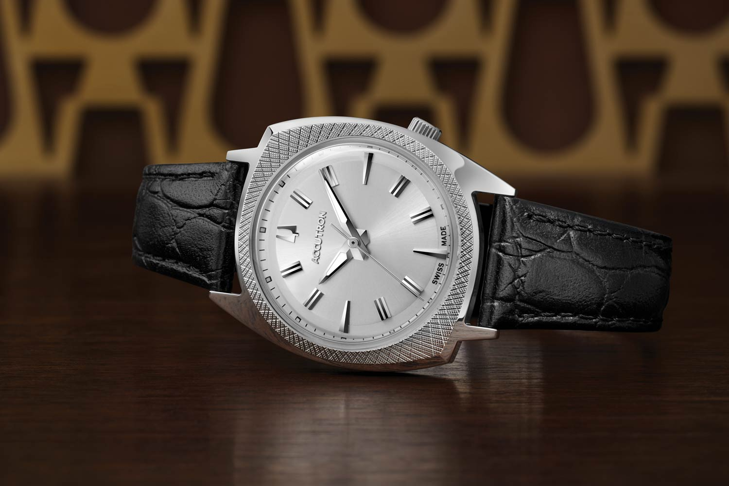 """The Accutron """"565"""" has a silver-tone stainless steel 34 mm case featuring a 3-hand silver white dial, bold hour makers, and an outer minutes ring."""