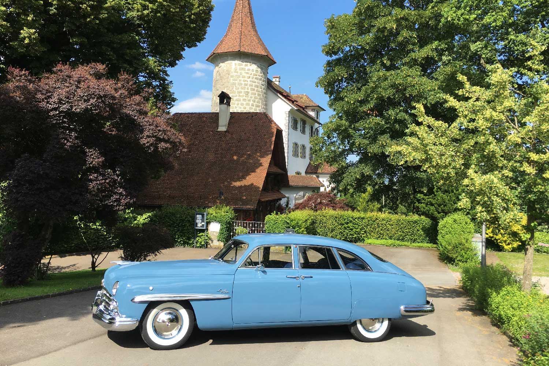 The restored blue Lincoln Cosmopolitan Town Car