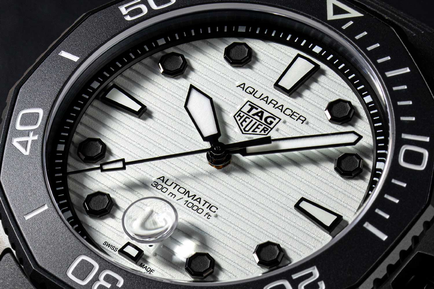 The new Aquaracer models focus on the enhancement of signature details such as the familiar 12-sided bezel and the dial's horizontal engraved lines. (© Revolution)