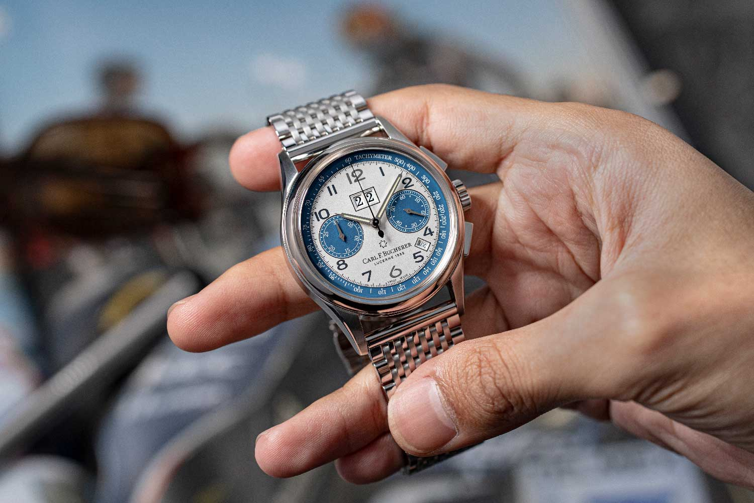 The dial shares a couple of elements with the Lincoln, including blue and chrome elements. The teal blue of the car is picked up on the subdials, running seconds, chronograph minutes and the tachymeter scale. (© Revolution)