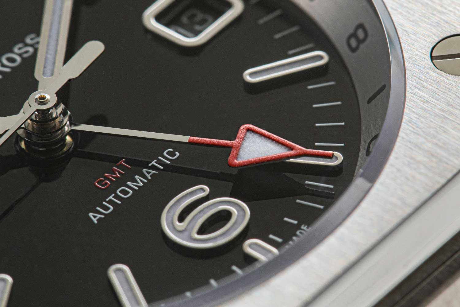 While the white hands on the main dial indicate the time at the wearer's current location, the red arrow-hand on the 24-hour graduated inner bezel shows the time in the country of origin. (© Revolution)