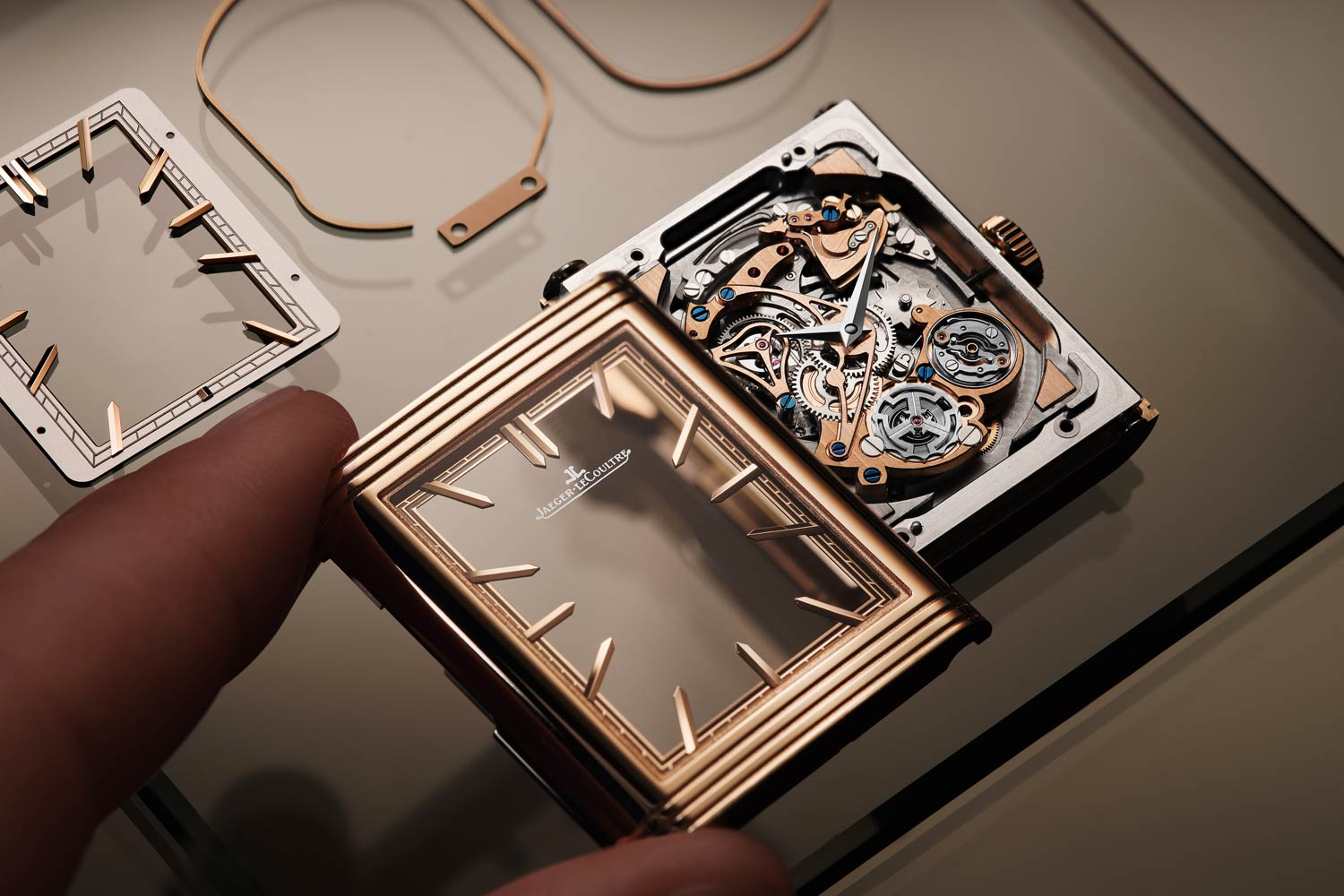 The watch presents a clearly defined architecture - a large bow-shaped bridge sweeping from 11 o'clock to 7 o'clock, faceted indexes that are cantilevered from the chemin de fer minutes track and gleaming, contrasting finishes.