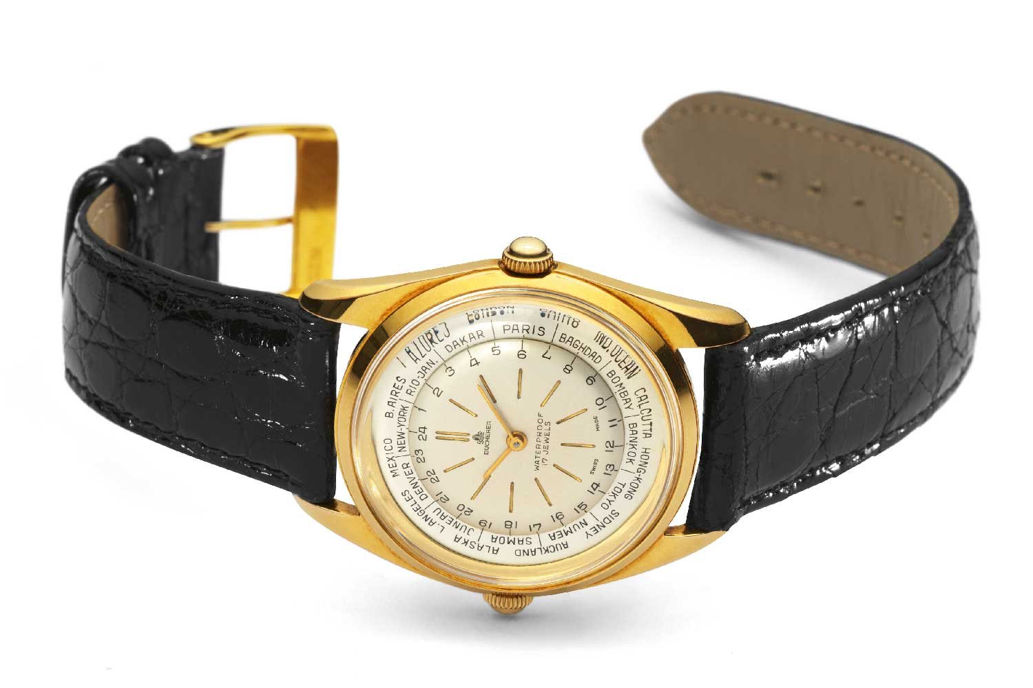 In the 1950s, the company produced its first world timer in gold, with two crowns with the alternate one at 9 o'clock that allowed for adjustment of the internal city ring.